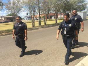 Officers head toward the volunteer teens hosting a faux drinking party at a  Controlled Party Dispersal training in the Rio Grand Valley on Aug. 8.