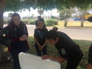 Local CBS station cameras look on as Mission Police Department Officer Nora Lozano trains with volunteer teens at a Controlled Party Dispersal training in Weslaco on Aug. 8.