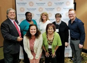 The Waxahachie Regional Forum participants take a break from note taking to strike a pose for the camera.